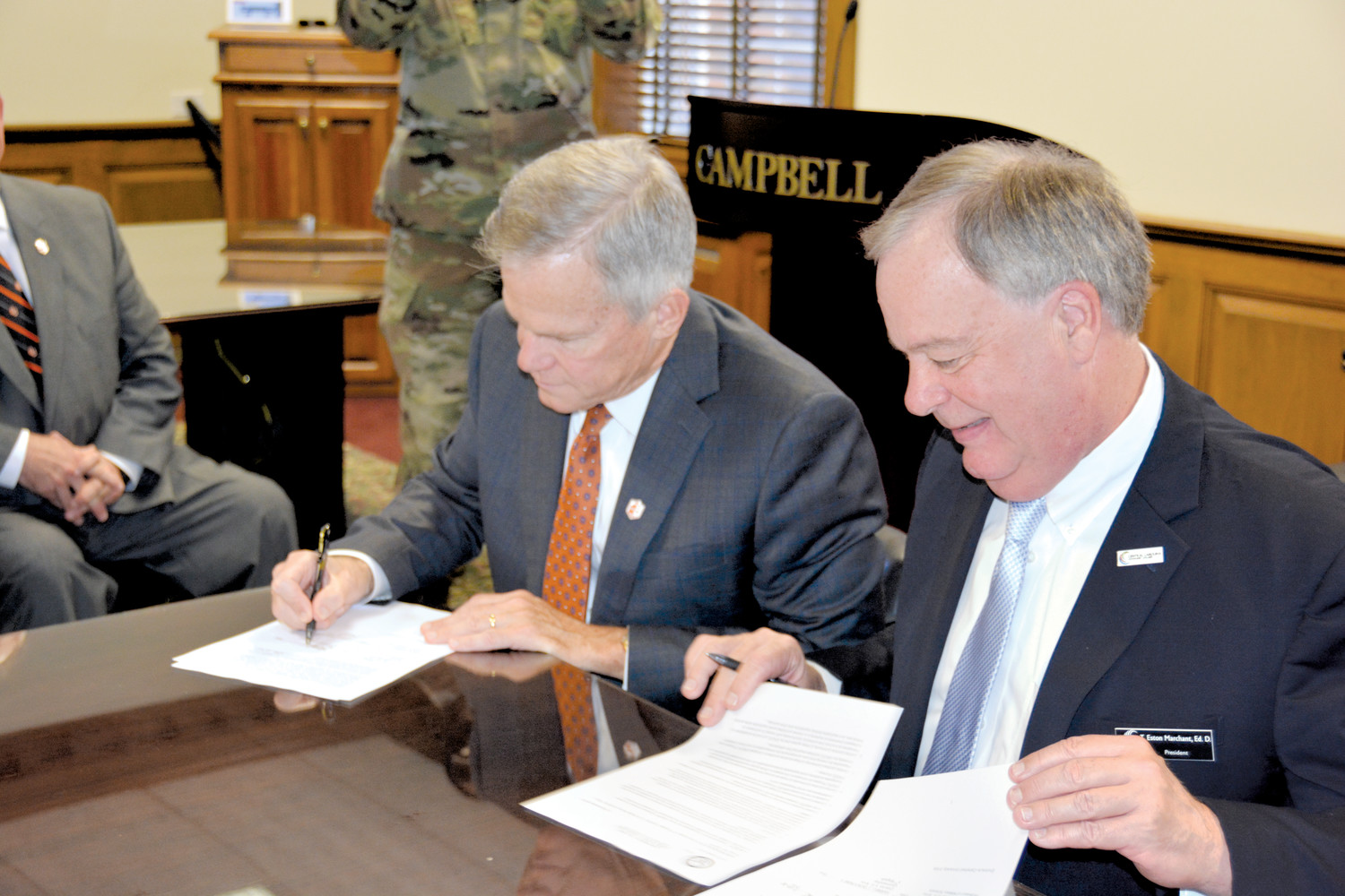 Campbell University President Dr. J. Bradley Creed and Central Carolina Community College President Dr. Bud Marchant sign an agreement allowing smooth transition of students interested in studying military science between the two schools.