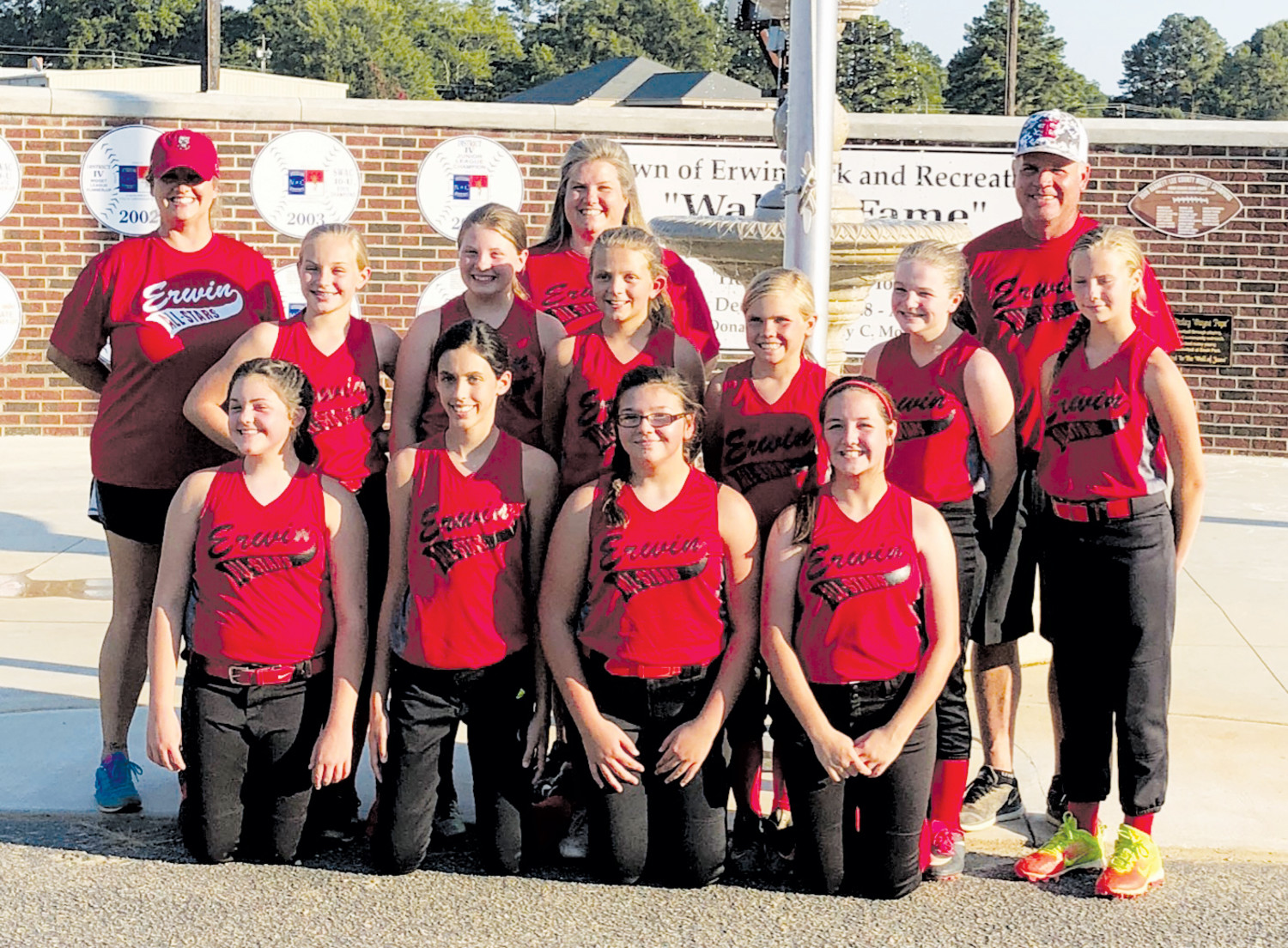 The Erwin Tar Heel 12U Softball All-Stars played yesterday in the District IV championship game against Western Harnett. They are, bottom row, from left, Baylee Reagan, Carleigh Hemby, Sabrina Black and McKenna Moore. Top row, from left, are Reese Penny, Madelyn Parker, Camryn Conway, Jenna Underwood, Whitni Royal and Lexi Davis. (Not pictured is Ashari Watlington.) Erwin All-Star coaches are, from left, Toni Hall, Misty Parker and head coach Wayne Underwood. They lost their first tournament game on Tuesday night to Western Harnett, 15-9.