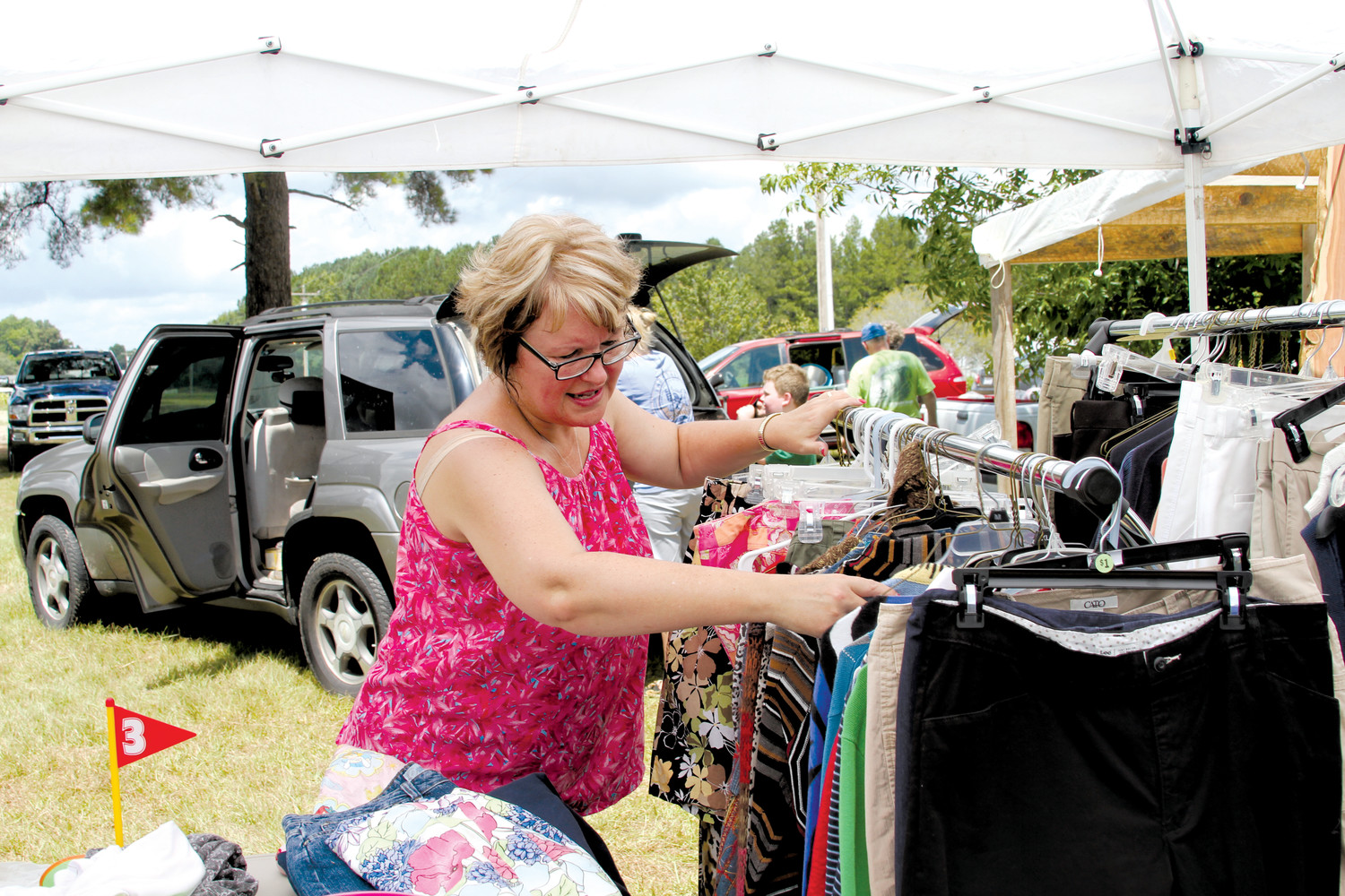 Rose Autry looks through a rack of clothing during last year's Maxwell Road Endless Yard Sale event Saturday. The yard sale runs through Sampson and Cumberland counties.