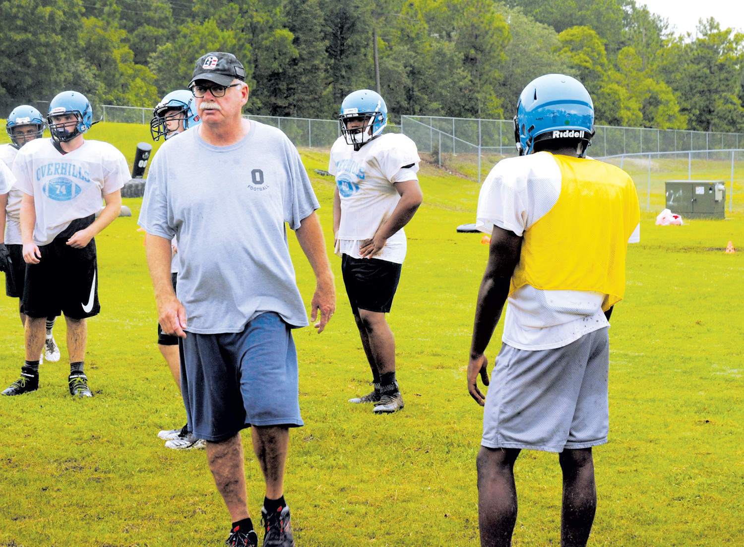 Overhills Jaguars head varsity football coach Mark Kirk surveys his players during an early-August practice in Cameron. His team's roster may not be as deep as last season, but the 3A/4A Jaguars team will put Harnett Central to the test, with their ability to spell and substitute role players between series. Overhills plays at Harnett Central at 7 tonight.