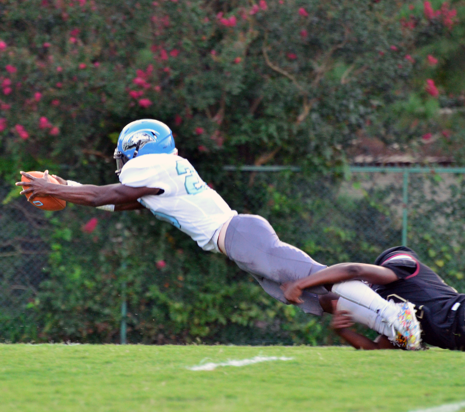 Overhills' DeShaun Lewis stretches out to score the first of his three rushing touchdowns at Harnett Central Friday night. The Jaguars would go on to score four more rushing touchdowns and two passing touchdowns as a team, hammering Harnett Central, 50-13.