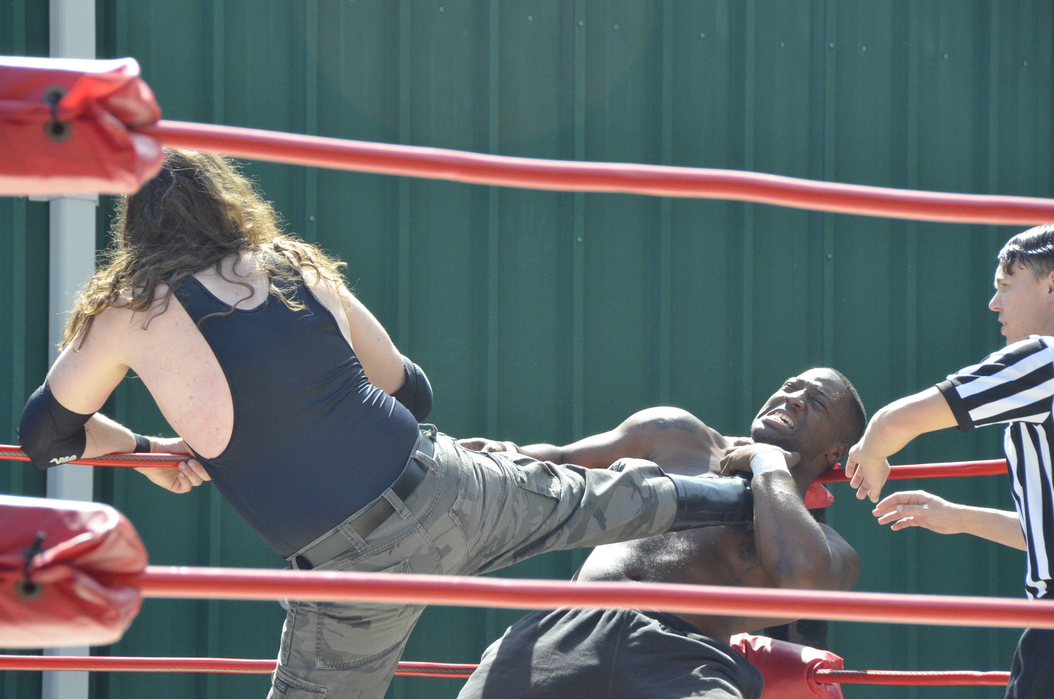Travis 'Mason Jar' Dixon lays the leather to Gem Stone in the opening match of Saturday's Ring Wars Carolina event at Fit 4 Life gym in Dunn. Stone won via disqualification, then later wrestler Dixon again in Dunn Street Fight match with his partner Flex Simmons. Kris Nemesis was also in that match, but Stone and Simmons were victorious.