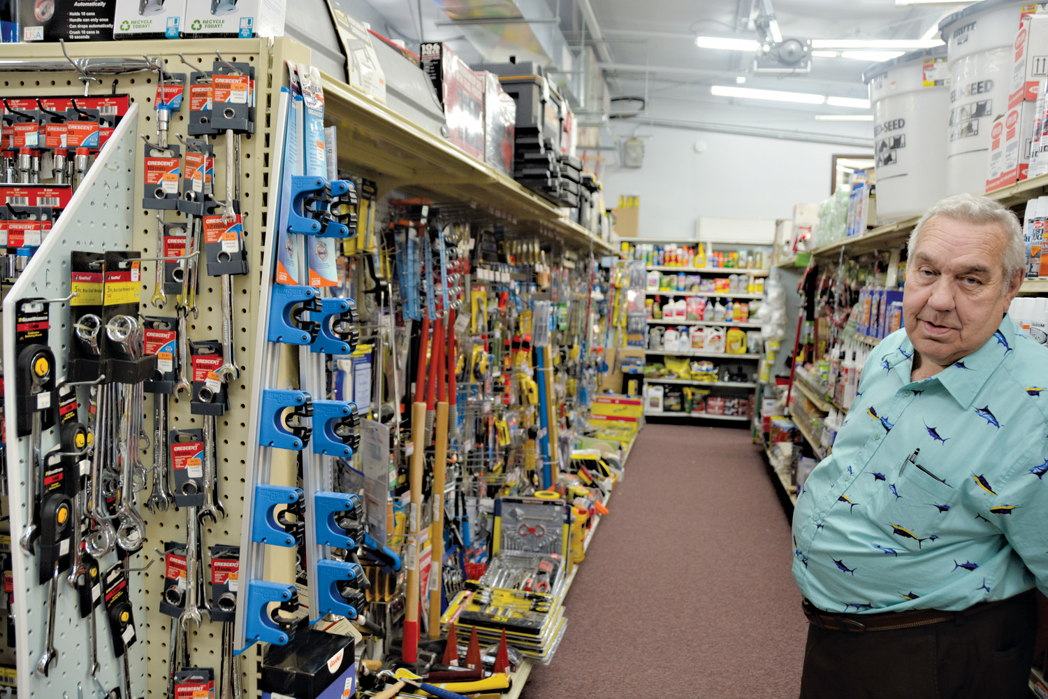Carl Underwood stands in one of the aisles stocked with a full inventory of hardware items at the Plainview Supply Store in the Plain View community. The store will hold a grand opening of its new store.