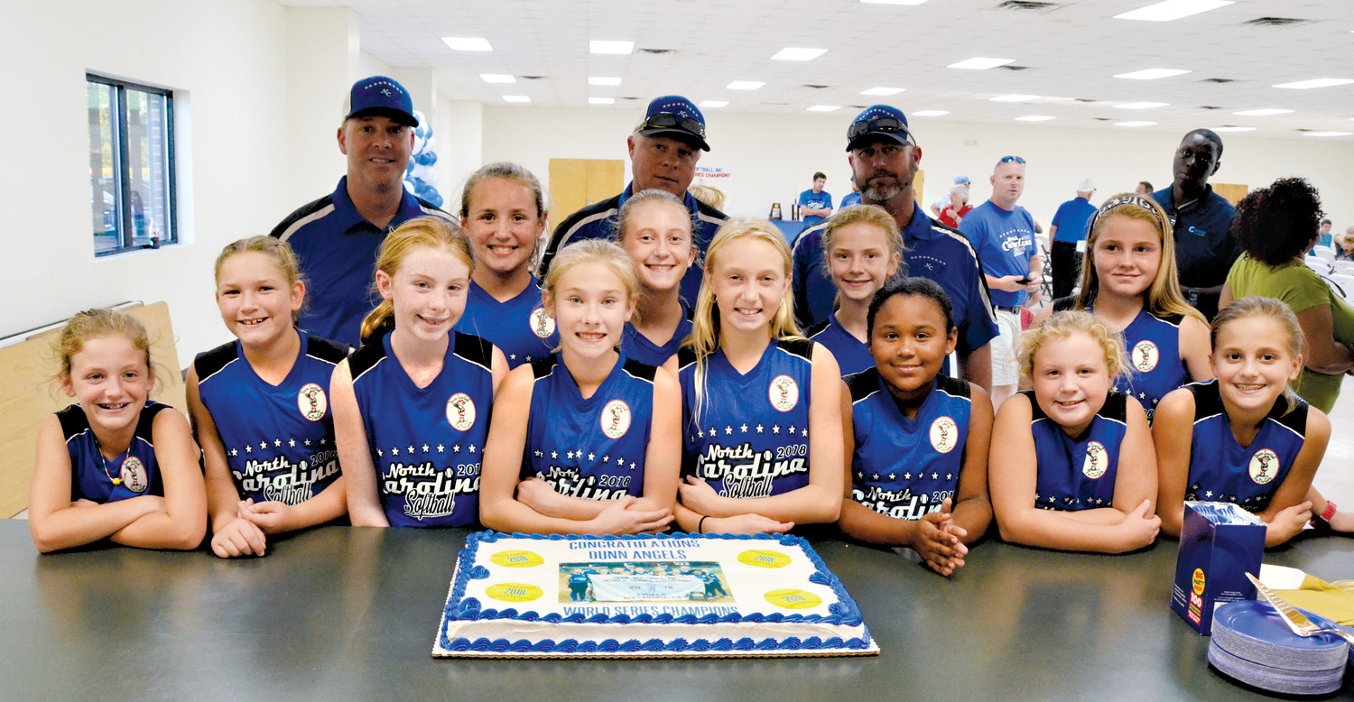 Dunn's World Champion Angels (10U) Dixie Youth Softball All-Stars were served Little Caesars pizza and a custom cake at their welcome ceremony, put on by the City of Dunn Wednesday. They are, in no particular order, Kara Beth Benton, Peyton Herring, Samantha Carter, Reagan Adams, Jordyn Christopher, Eva Kate McLamb, Olivia Crumpler, Zoey Godwin, Molly Bass, Addy Stanley, Aubrianna Collas and Ella Clark. Coaches Clay Stanley, Adam McLamb and Cullen Clark stand at back.