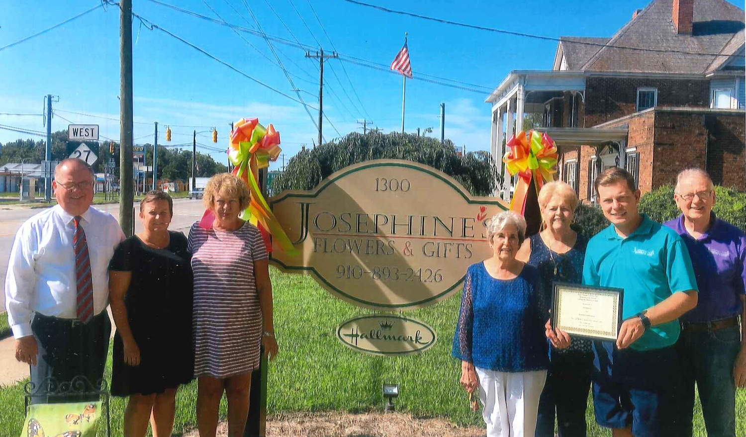 Pictured from left are Paul and Jennifer Phillips, owners of Josephine's Flowers and Gifts; Beverly Brown; Mary Jane Matthews, chair of Beautification Committee; Diane Johnson, member of award committee; Matt Brown, manager of Josephine's Flowers and Gifts; and Ron Hise.
