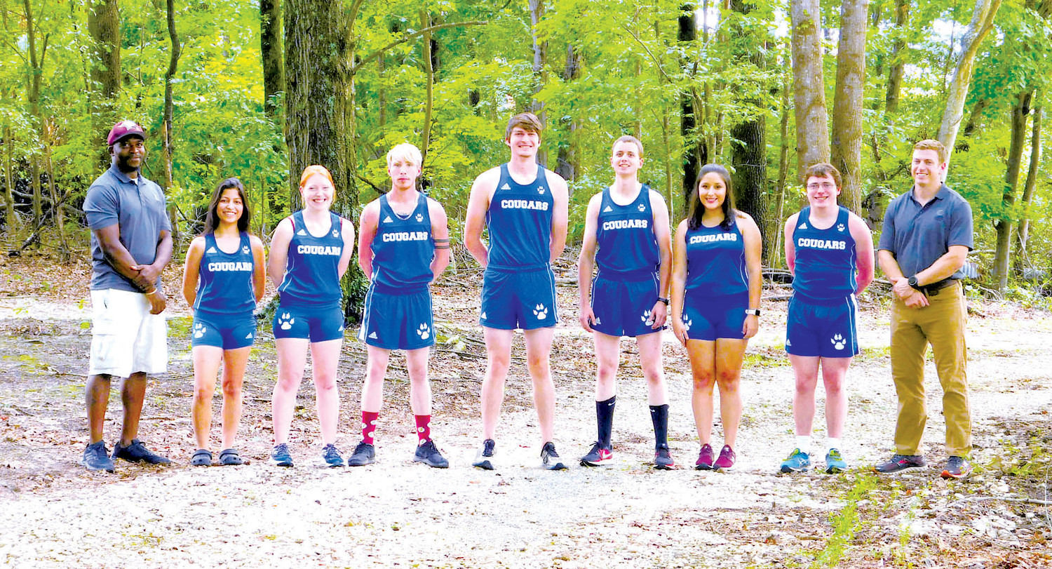 Members of the 2018 Central Carolina Community College cross country team are pictured, left to right, coach Cliff Scarborough, Nuvia Guardado, Alicia Walker, Britt Lehman, Seth Hoyle, Issac Stoutland, Lupe Vasquez, Brent Holder, and Coach Jacob Ashworth. (Not pictured is Grayson Lynch.)