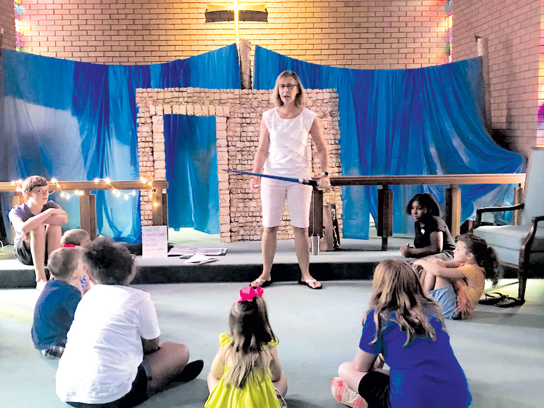 VBS leader Caroline Wilson shares a 'Rescued By Jesus' Bible story with VBS children.