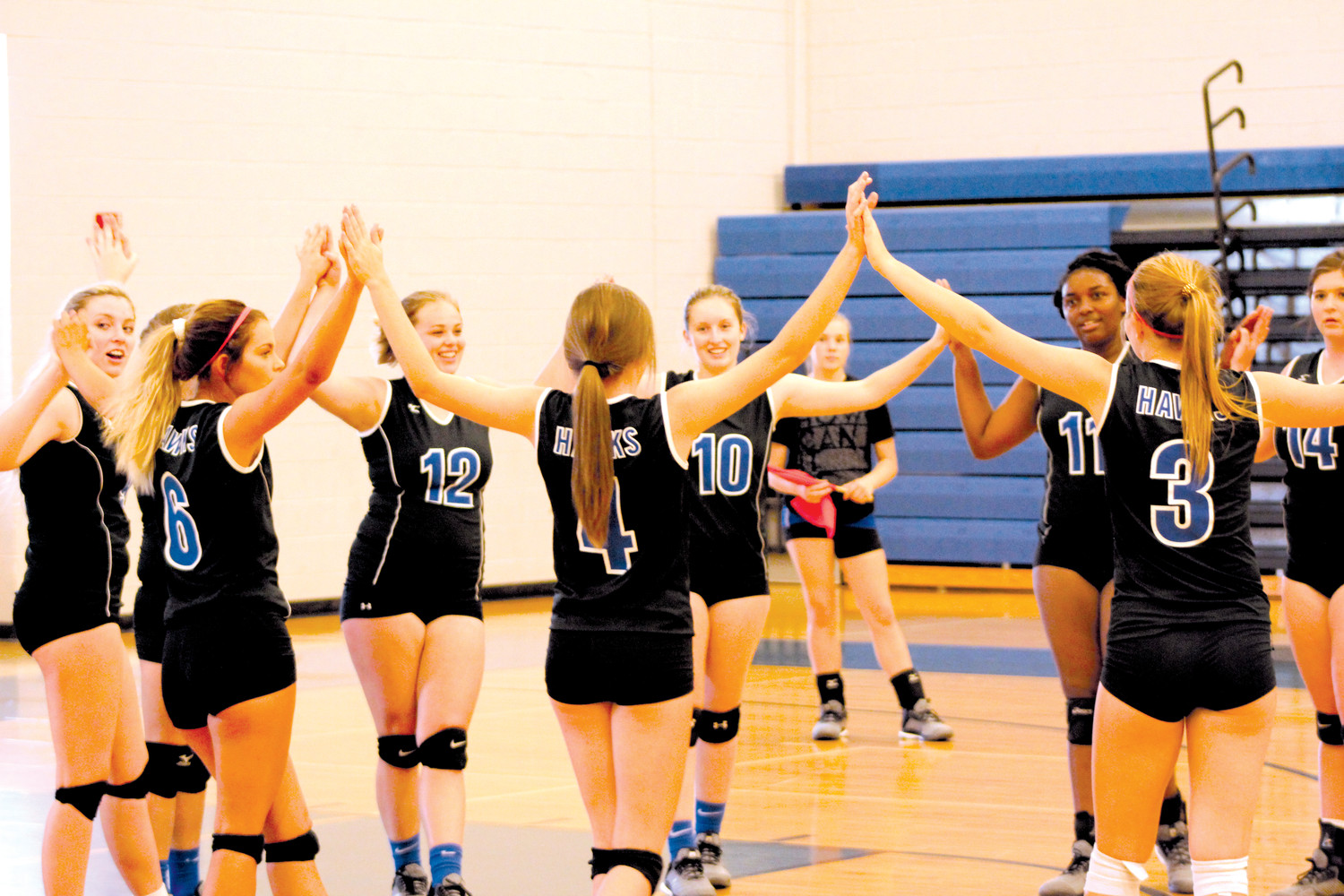 Triton's volleyball team celebrates their victory over Midway, 3-2, Monday night.