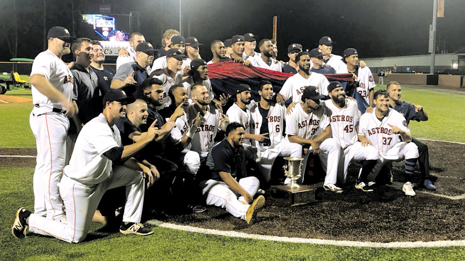 The Buies Creek Astros claimed the Carolina League title Tuesday night. Here they pose with the Mills Cup Trophy.