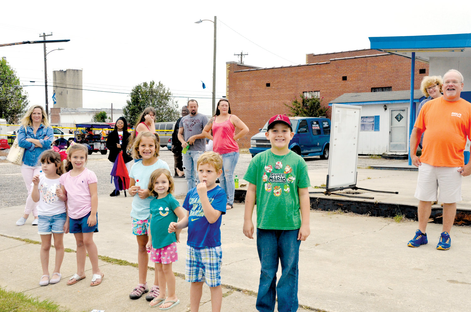 Children eagerly wait for their chance to nab some candy during Saturday's Denim Days Parade. Pictured, from left, are Baylee Pleasant, Allie Beasley, Lyla Murphy, Linley Murphy, Keaton Murphy and Holden Murphy.