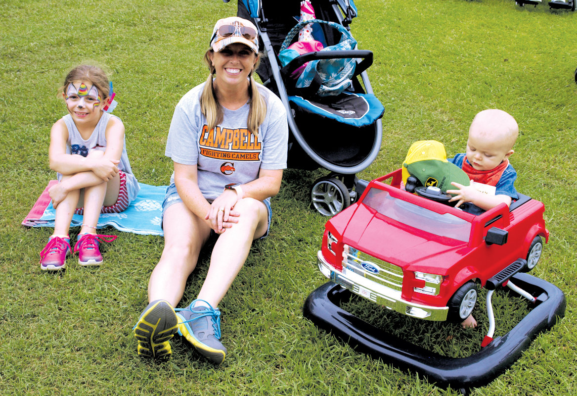 Natalie, Anistan and Beau Pusser of Erwin find a spot to relax and enjoy the festivities Saturday during Erwin's 54th annual Denim Days.