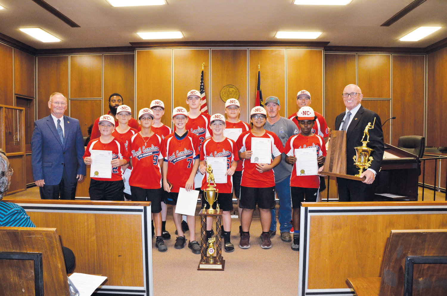 The Dunn City Council honored the Dunn Majors 12-Under All-Stars Tuesday night. The team won the state championship and went on to finish third in the Dixie Youth World Series. Front row from left are council member Chuck Turnage, Jarrett Cooper, Hunter Tyndall, Braxton Davis, Wyatt Lucas, Gabe Dapuyen, Jalen Evans and Dunn Mayor Oscar Harris. Second row from left are Dunn Recreation Director Brian McNeill, Tripp Westbrook, John Nelson McLamb, Anthony Jones, Ross Stevens, assistant coach Kevin Davis and head coach Charlie Stevens.