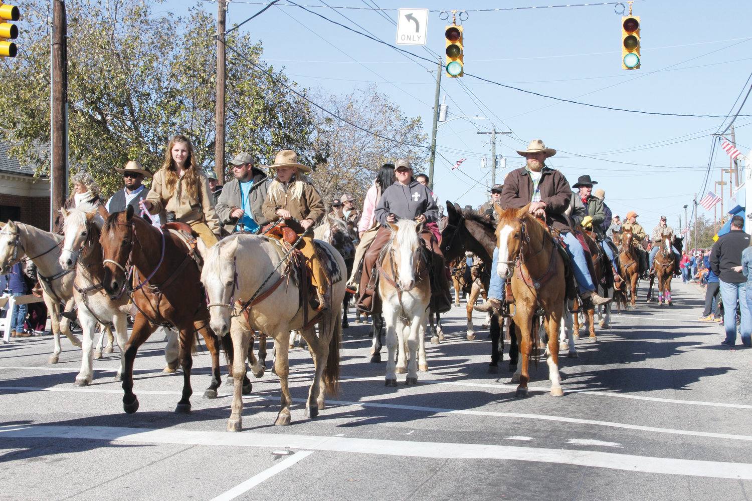 Horses parade through Coats as part of Farmers Day festivities in a previous year. The parade will once again be held Saturday at 1 p.m.