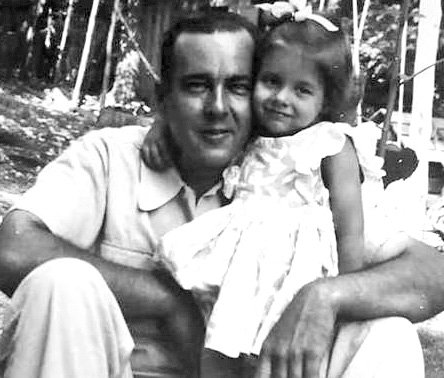 George Palmer, one of the operators at the Buckhorn Hydroelectric Plant, poses with his daughter, Joan, in 1943 after he moved his wife, Hazel, and child to the side of Buckhorn Dam located near Corinth.