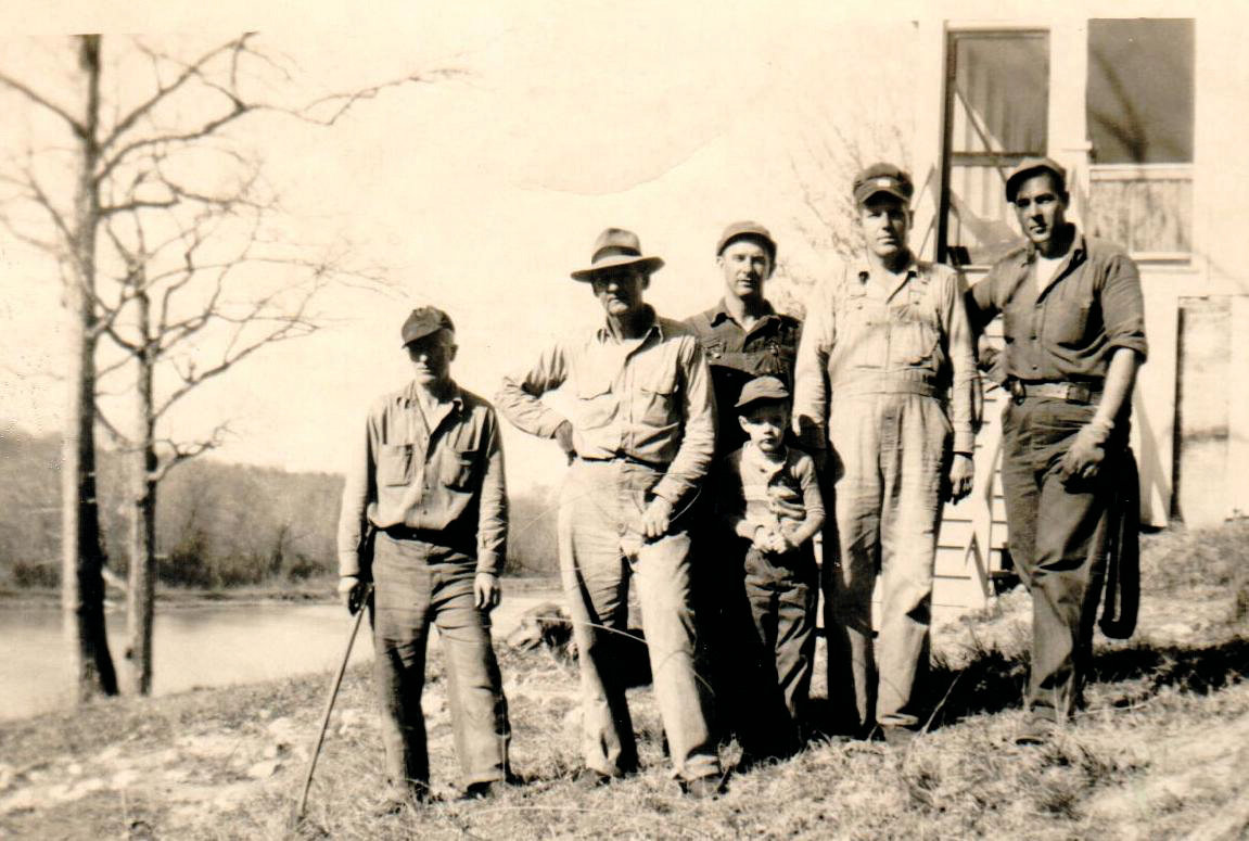 This picture portrays the men who were responsible for keeping the Buckhorn Power Plant running in 1943. They are Norris Thomas, superintendent; Avery Marks; Royce Dickens; Johnny Martindale; and George Palmer; plus Avery's son, Sammy.