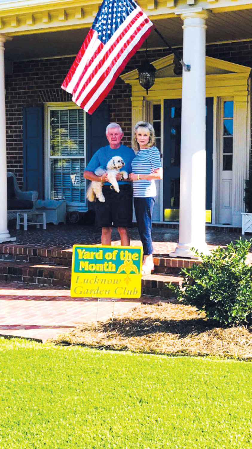 Dunn Yard of the Month for September..Chuck and Donna Robinson with their dog, Cam, at their home located at 121 Fairfield Circle, Dunn. The Robinson home was named the Lucknow Garden Club Yard of the Month for September.