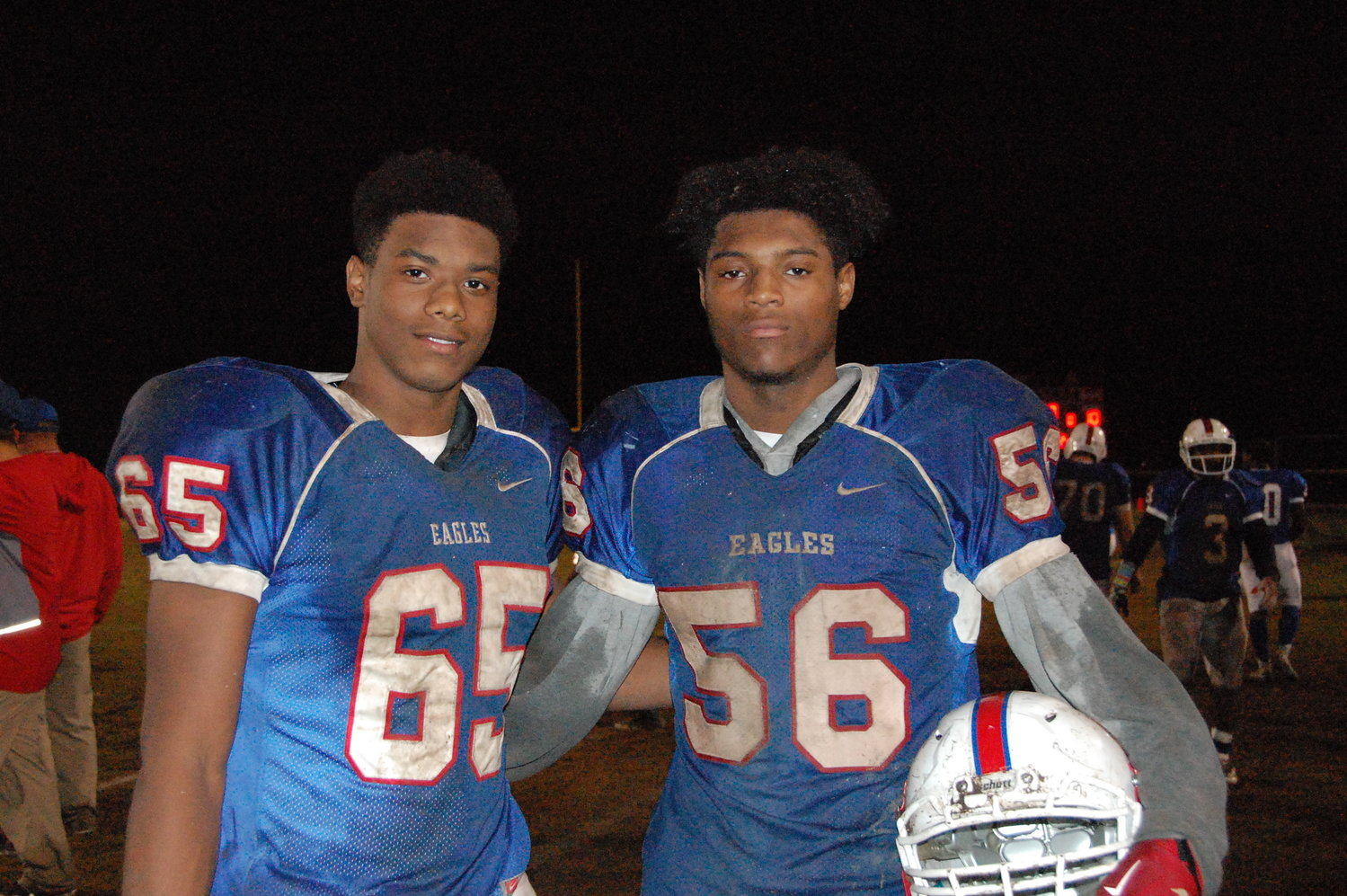 Jaysten McLean (No. 65) and Eric Bradshaw (No. 56) pose after Monday's loss to Union Pines. 'Spooking' quarterbacks and catching interceptions, these two best friends keep things fun and entertaining for Western Harnett's football team. Both standing over 6 feet tall, they are known as the 'Tall Boys' for the Eagles' Defense.