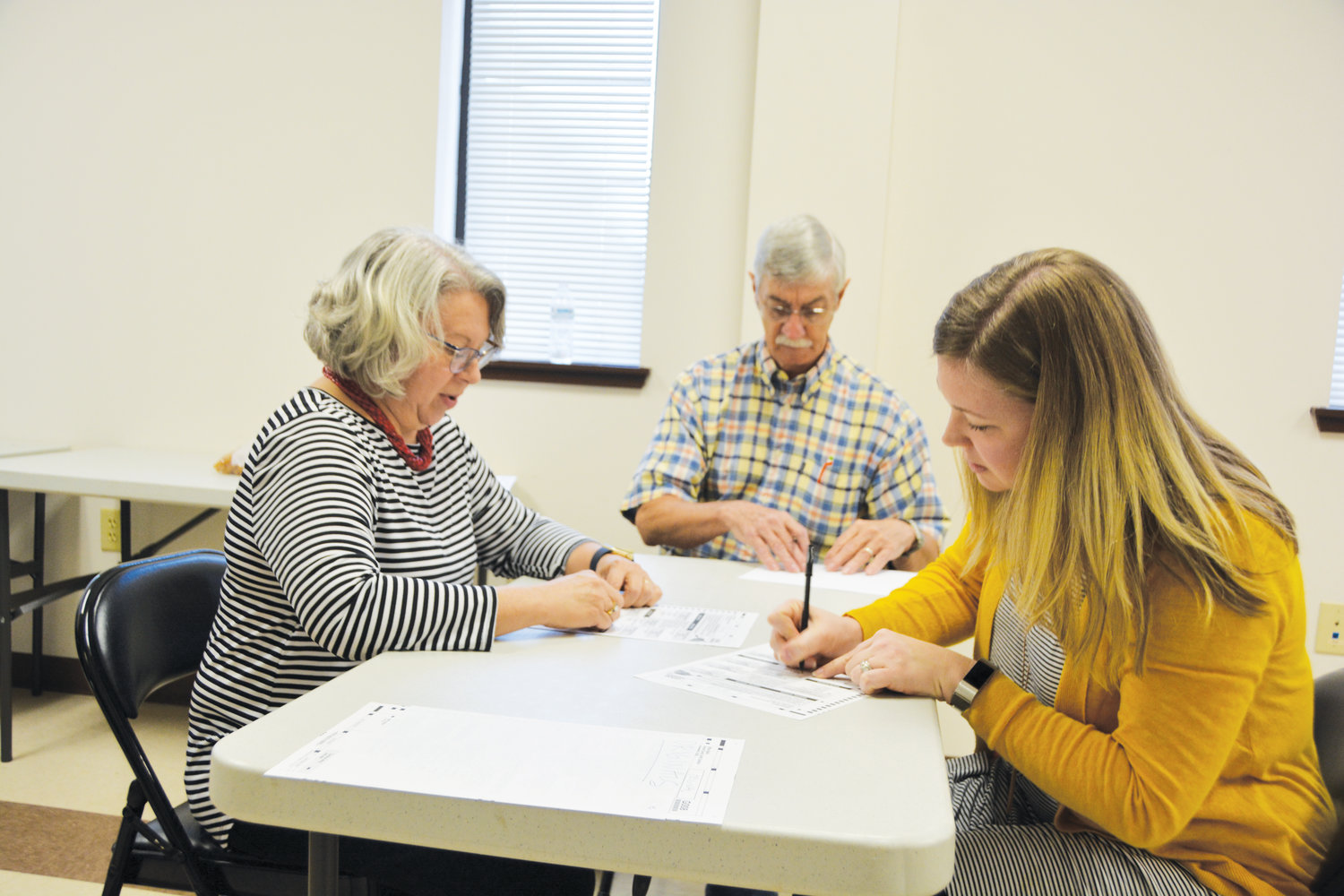 Northwest Harnett election judges duplicate ballots at the Harnett County Board of Elections Wednesday. Brenda Schmadeke, at left, is reading ballots while Amanda Duntz, at right, fills out ballots. Chief Judge Charles Stirewalt is overseeing the proceedings.