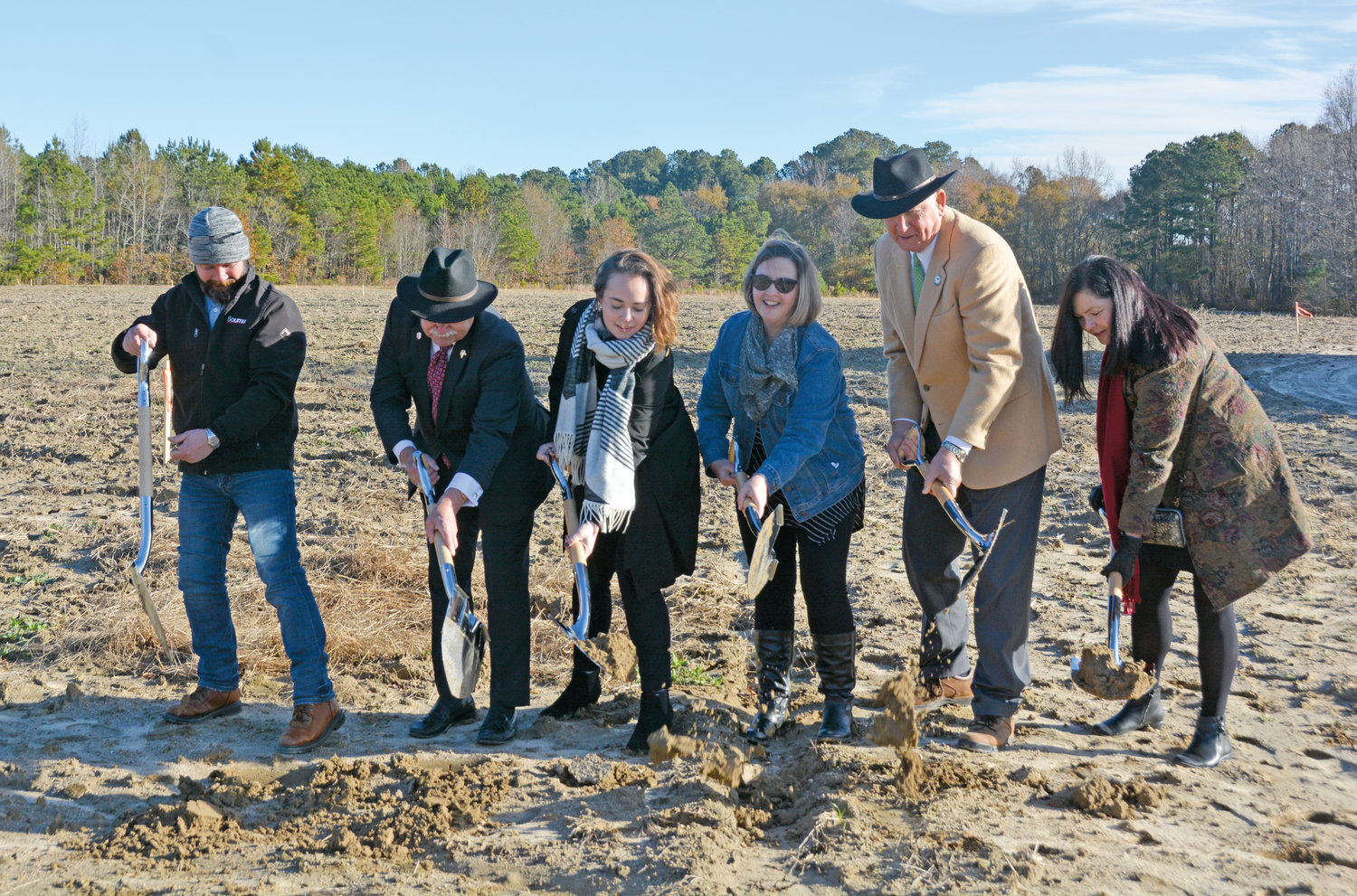 Officials from the Carolina Charter Academy joined town officials and broke ground on a new school near Angier Tuesday. Shown with shovels are Don Langlois, Stephanie Nall, Jaime Stoops, Julie Knudon, Angier Mayor Lew Weatherspoon and Fuquay-Varina Mayor John Byrne. The school is set to open in the fall of 2019.