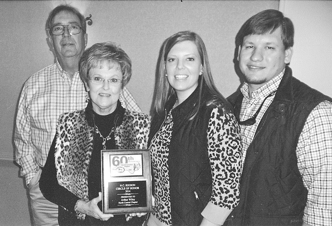 Shelby Ricks (second from left) accepts the Circle of Honor award from the Antique Automobile Club of America's North Carolina Region. Pictured with her are, from left, Lemuel Ricks, Marlo Williams and Garrett Williams.