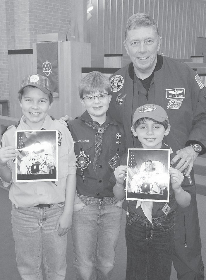 Cub Scouts from Pack 239 in Roxboro, left to right, Alex Leonard, Hayden Howard, and Dalton Mise in Greensboro with astronaut Michael E. Fossum.