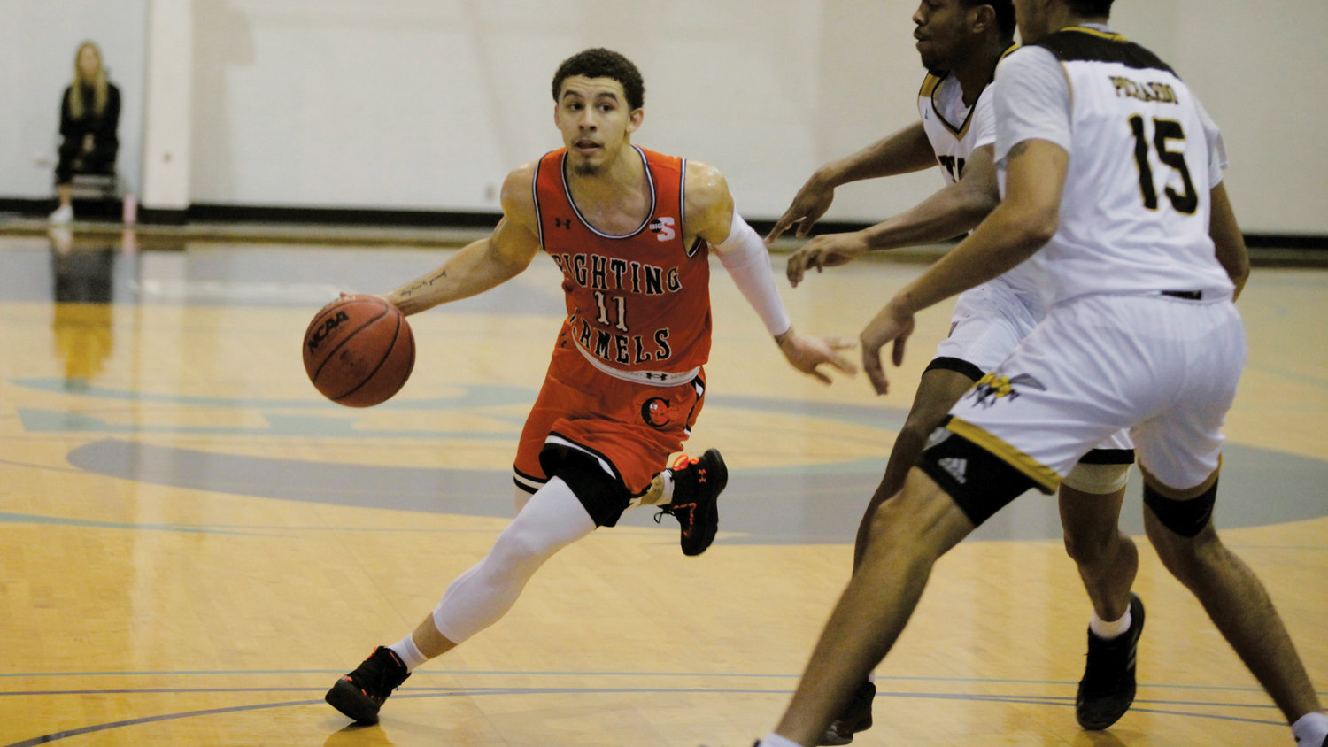 Jordan Whitfield drives to the hoop in Campbell's win over Alabama State on Saturday at the St. Pete Shootout at Eckerd College in St. Petersburg. Fla.