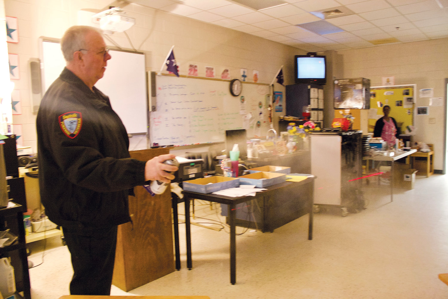 Allen Bricker, a forensic supervisor at the Fayetteville Police Department, speaks to students in Stacie Siebert's honors biotechnology class at Overhills High School.