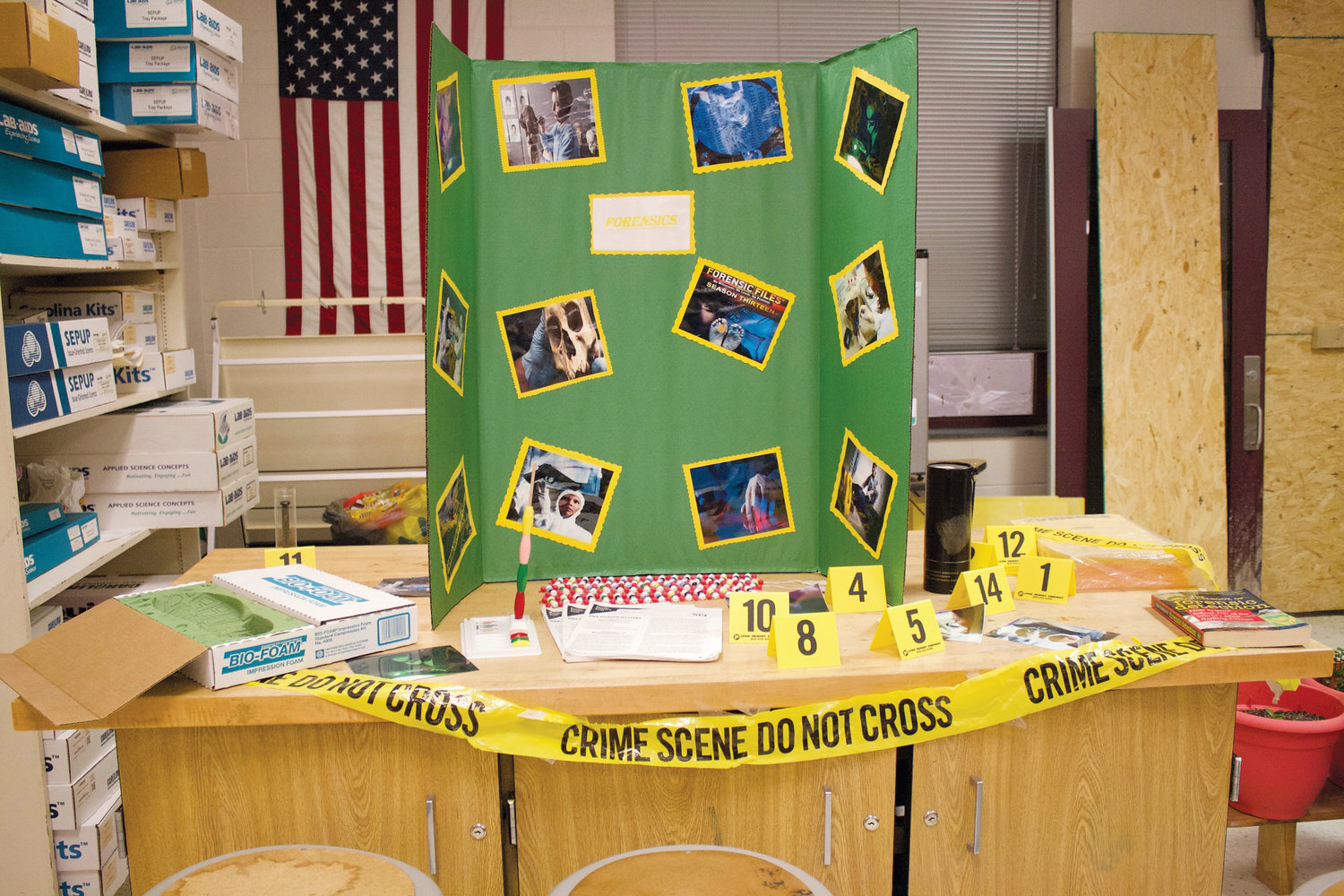 A forensics display is set up in Stacie Siebert's class at Overhills High School during a visit by Allen Bricker, a forensic supervisor at the Fayetteville Police Department.