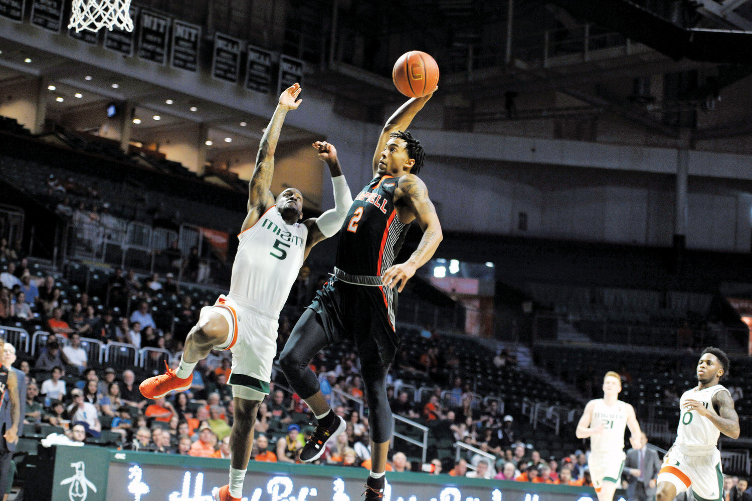 Ja'Cor Nelson drives to the basket for two of his 14 points in Campbell's loss at Miami on Saturday.