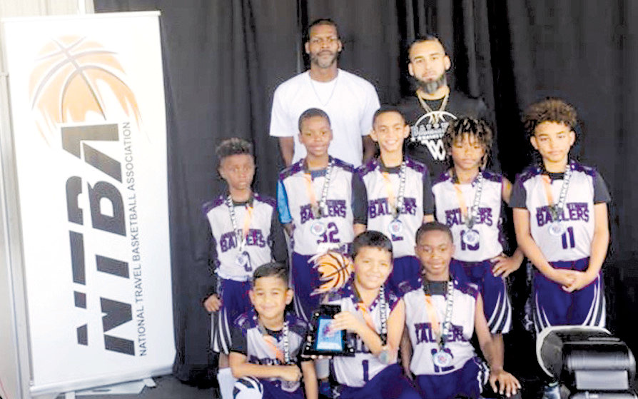 The Harnett Strong Ballers fourth-grade team finished runner up in the National Travel Basketball Association championship this summer. Bottom row, from left, are Yadiel Arredondo, Yazid Espinoza and Gavin Matthews. Middle row: Kyrese Williams, Malachi Cooke, Josh Alvarado, Cy'Mani Surles and Kobe Plata. Back row: assistant coach Dwain Ellis and head coach Nate Plata.