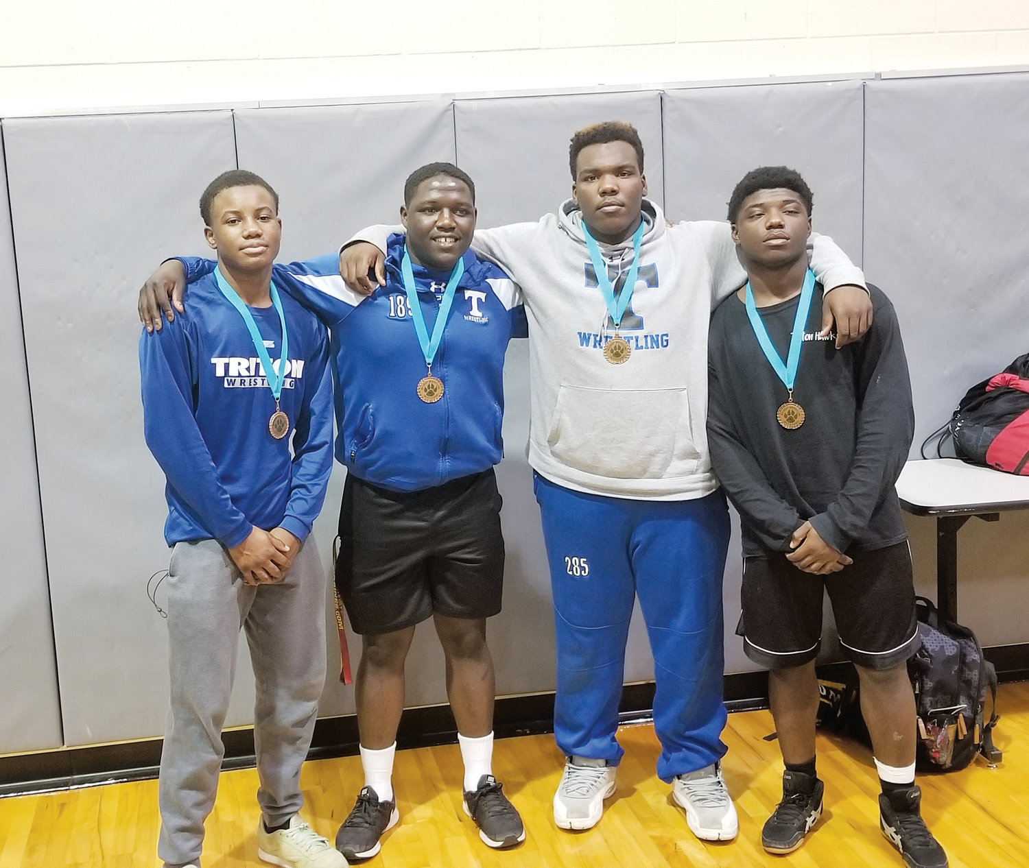 Triton wrestlers Nick Williams (145), Tyre Cameron (220), Michael Carvin (285) and Romello Cowan (170) each placed third in the individual tournament at West Johnston on Saturday.