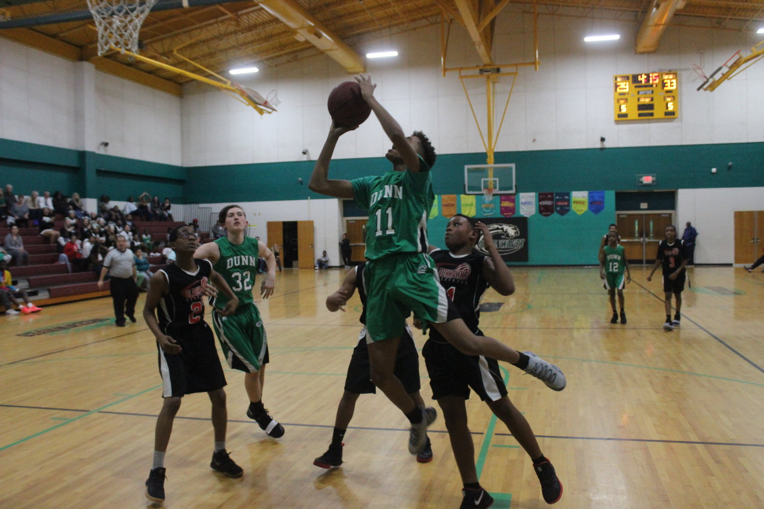 Jaeshaun Murchison soars for two of his 18 points in Dunn's win over Shughart. Murchison scored 11 points in the fourth quarter to rally the Greenwaves to victory.