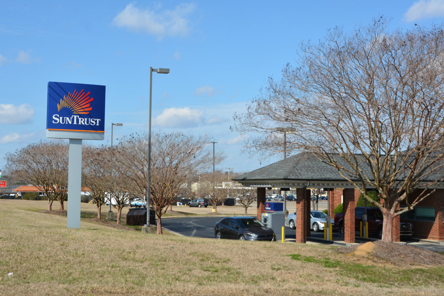 SunTrust Bank branches, like this one in Erwin, could be affected by a merger with BB@T which was announced Thursday. The two banks will operate under a different name that has not been released. It is not known how the merger will affect local branches of either bank.