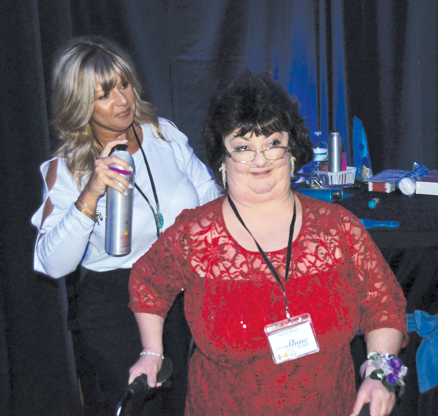 Natalie Barnes of Benson gets a touch of hairspray from volunteer Stephanie Norris of Mt. Carmel PFWB Church which hosted Night To Shine, a prom for special needs guests in the area.