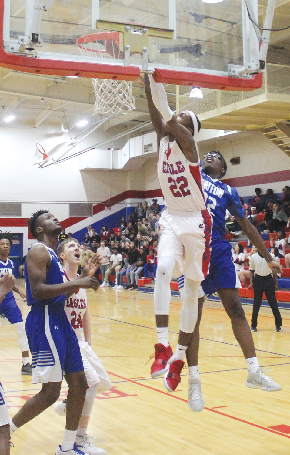 Western Harnett senior Tobias Dillard flushes home an and-one dunk against Triton. Dillard had nine points and gave the Hawks trouble inside all night in the 64-61 overtime victory.