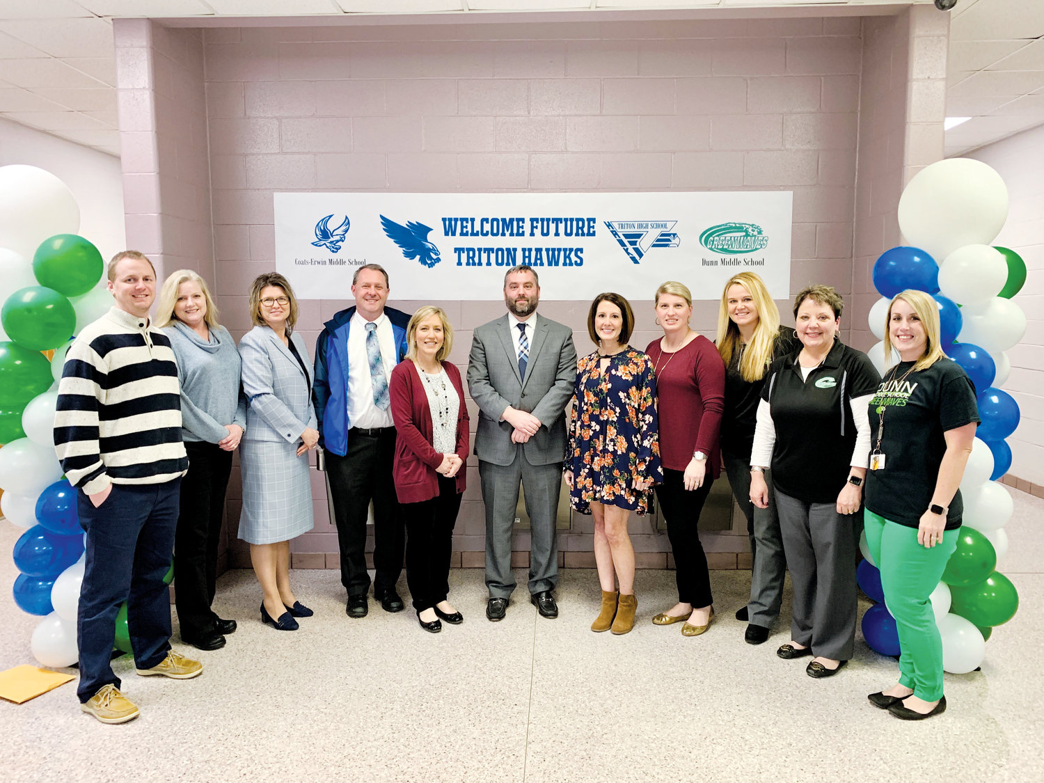 Pictured at the first Future Hawks Information Night are, from left, Triton High School counselor Jared Collier; Coats-Erwin Middle School counselor Lou Ann Jones; CEMS Principal Sharon Johnson; CEMS Assistant Principal Tre Perry; THS counselor Paula Parker; THS Principal Ryan McNeill; THS counselors Ashlyn Thompson and Morgan Colmenero; Dunn Midd School Assistant Principal Megan West; DMS Principal Dr. Janet Doffermyre; and DMS counselor Leslie Weaver.