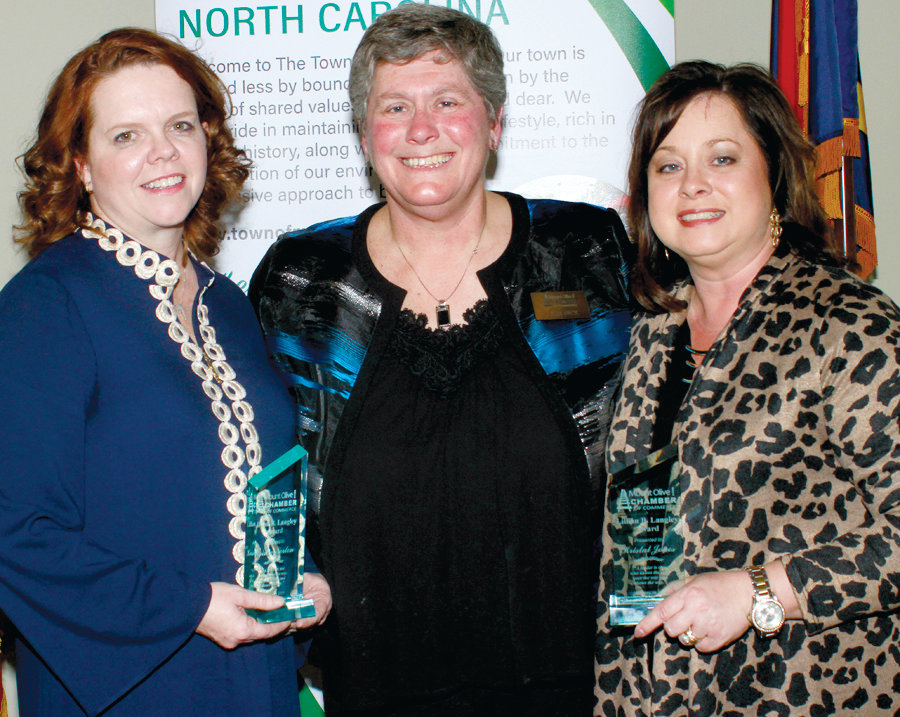 Mount Olive Chamber President Julie Beck, center, presented the Lillian B. Langlay Award to both Kristie Norton, left, and Kristal Jones, right, at the Mount Olive Chamber Banquet.