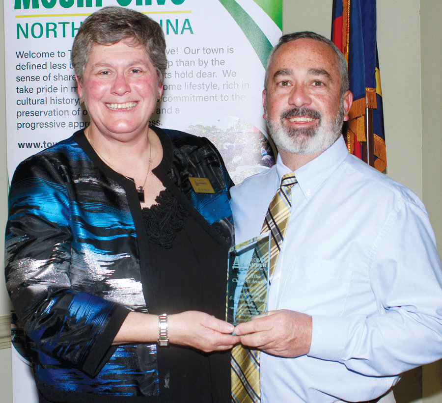 Mount Olive Chamber President Julie Beck, left, presented the Spirit of the Chamber award to Tony Martin, right.