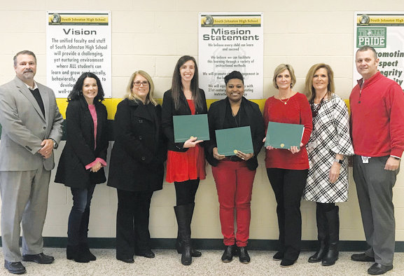 Pictured from left are Four Oaks Chamber Board President Tim Barbour, Missy Medlin with HomeTowne Realty, chamber Director Joan Pritchett, Teachers Lead Four Oaks recipients Tabitha Ward, Latissa Hampton and Joy McGee, South Johnston Assistant Principal Cecelia Banks and Principal David Pearce. Not pictured is Brandy Peters.
