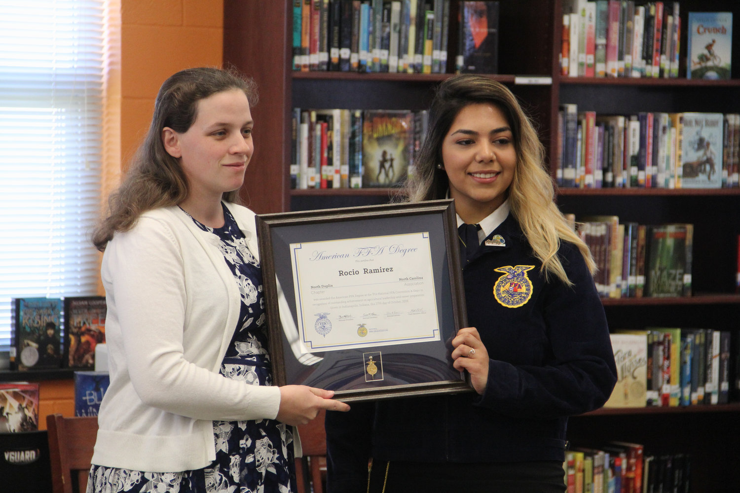 Rocio Ramirez (right) standing with North Duplin FFA Advisor Lynn Marshburn. Ramirez is only the fifth North Duplin alum to receive their American Degree and she becomes the first female North Duplin alum to do so.