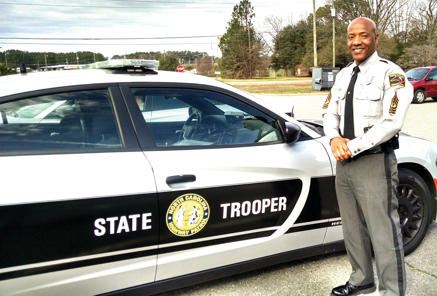 First Sergeant Doug Bowens is featured in this photo by his cruiser. He is Wayne County's new Highway Patrol first sergeant. He replaces First Sergeant John Bobbitt, who was transferred to Fayetteville. Sgt. Bowens, a 19-year veteran with the patrol, relocates here from Granville County.