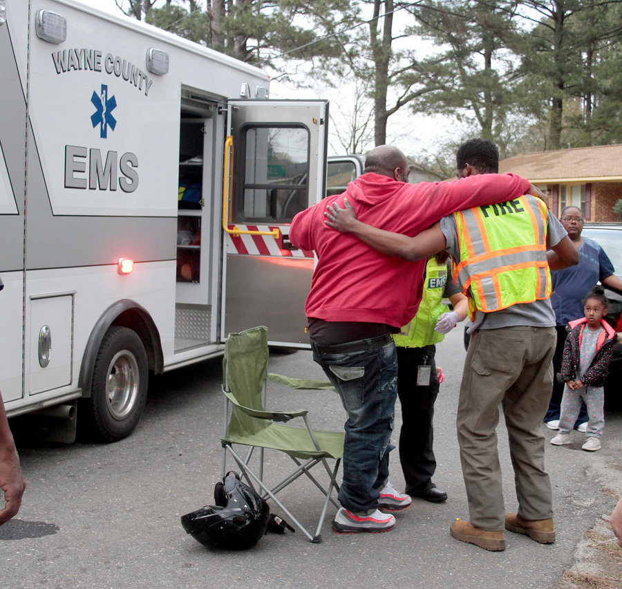 The victim being helped by medical personnel after the victim crashed into a car trying to avoid it Monday afternoon.