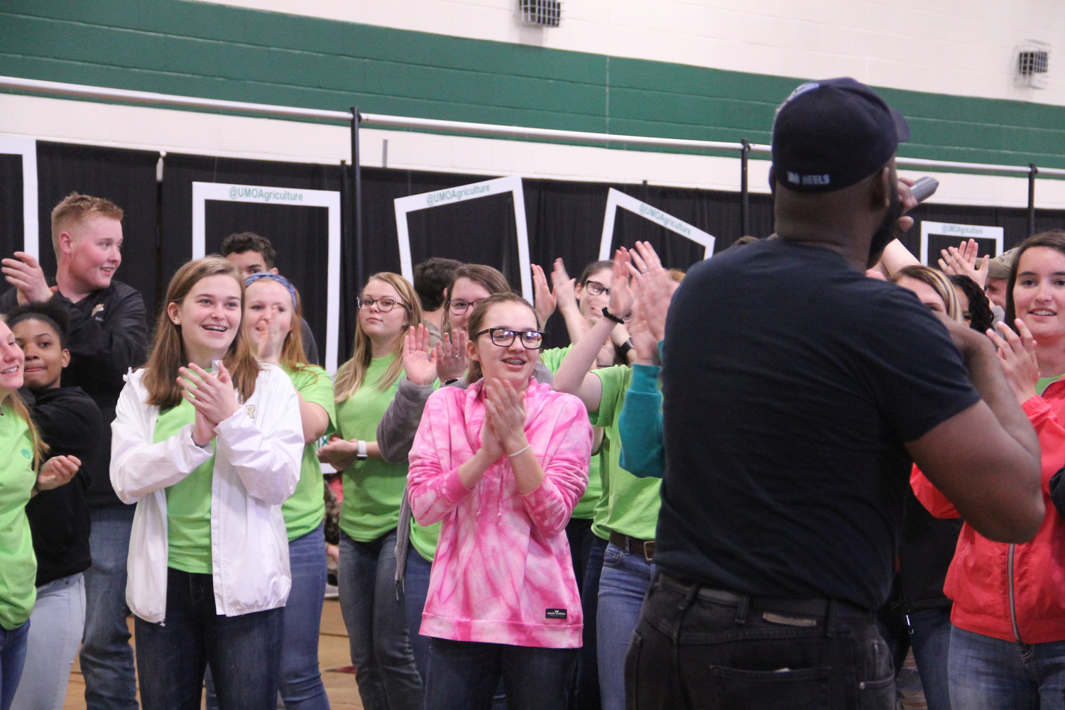DJ Sweet and Nice LJ hyping the crowd up for a dance-off in the Pope Wellness Center yesterday at AgFest.