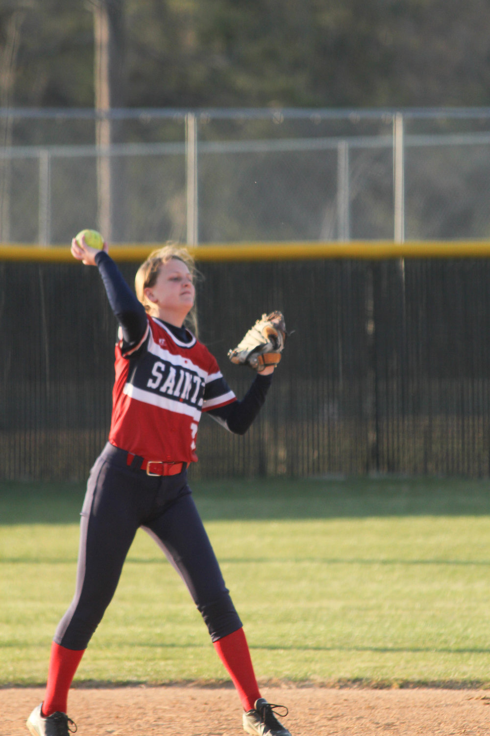 Senior Kayla Raynor throwing to first to pick up an out early on the Saints loss against D.H. Conley