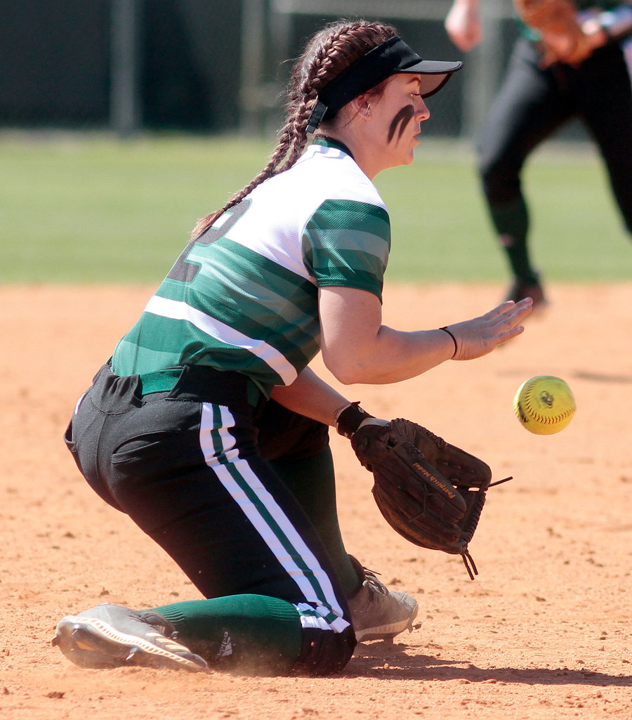 Callie Ferrell field a hard hit ball during game one of the Trojan's doubleheader today against King.