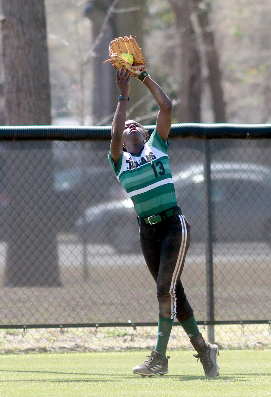 Charlene Thompson reeling in a flyout in the Trojans game one win.