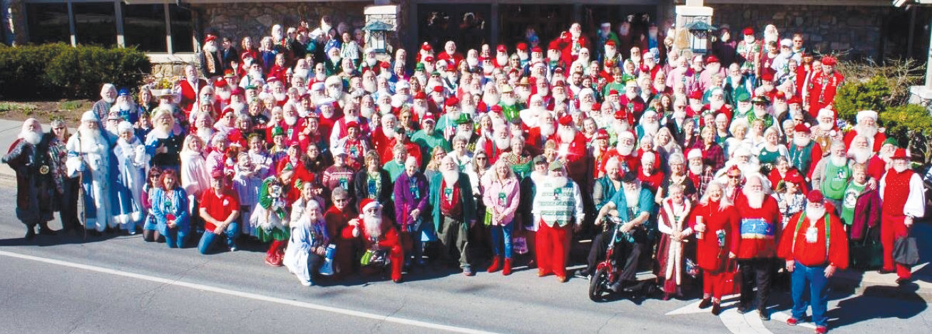 Hundreds of Santa Clauses from around the world are shown here at the Santa Family Reunion which was held in Tennessee. Among the attendees were Jesse and Debbie Ferrell Cann who live in Angier.