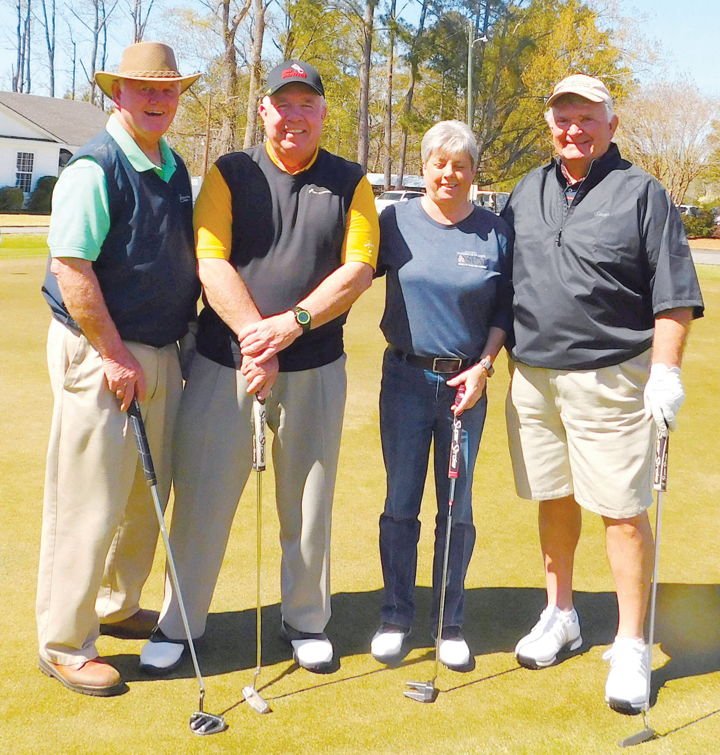Members of the second flight winning team in the sixth Central Carolina Community College Foundation Harnett Golf Classic were Joe Tart, Gale Tart, Ronnie Jenkins and Darrell Smith.