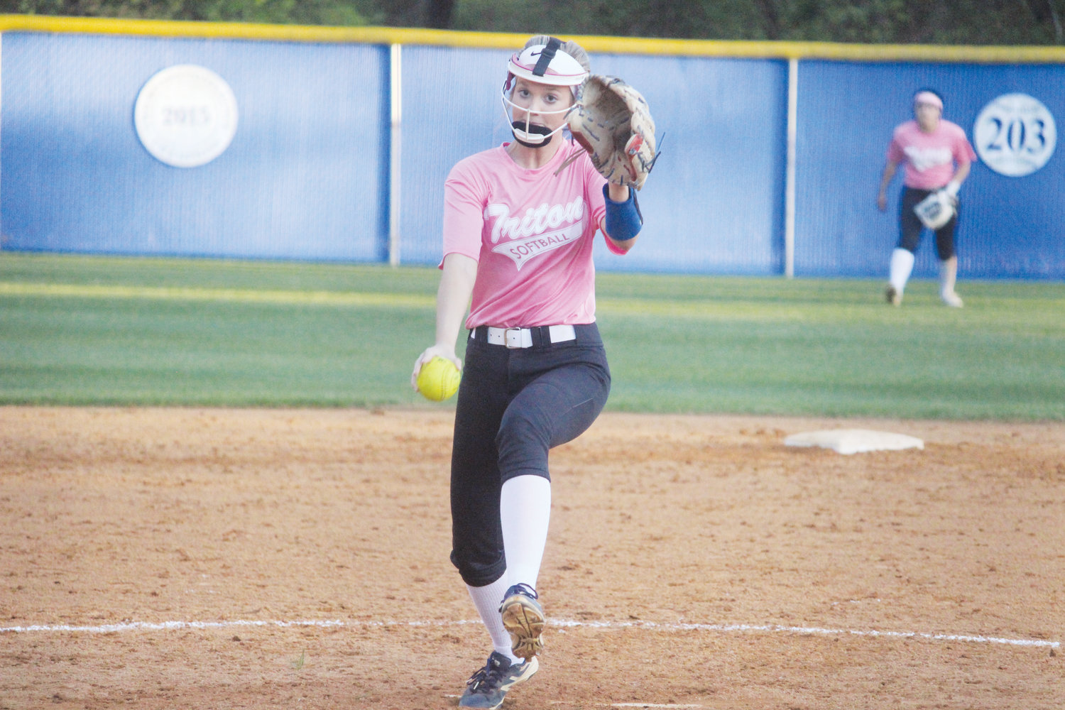 Caroline Marshall whips in a pitch. Donning a special 'pink out' jersey, Marshall picked up her sixth win of the season in Triton's 4-2 victory over Union Pines.