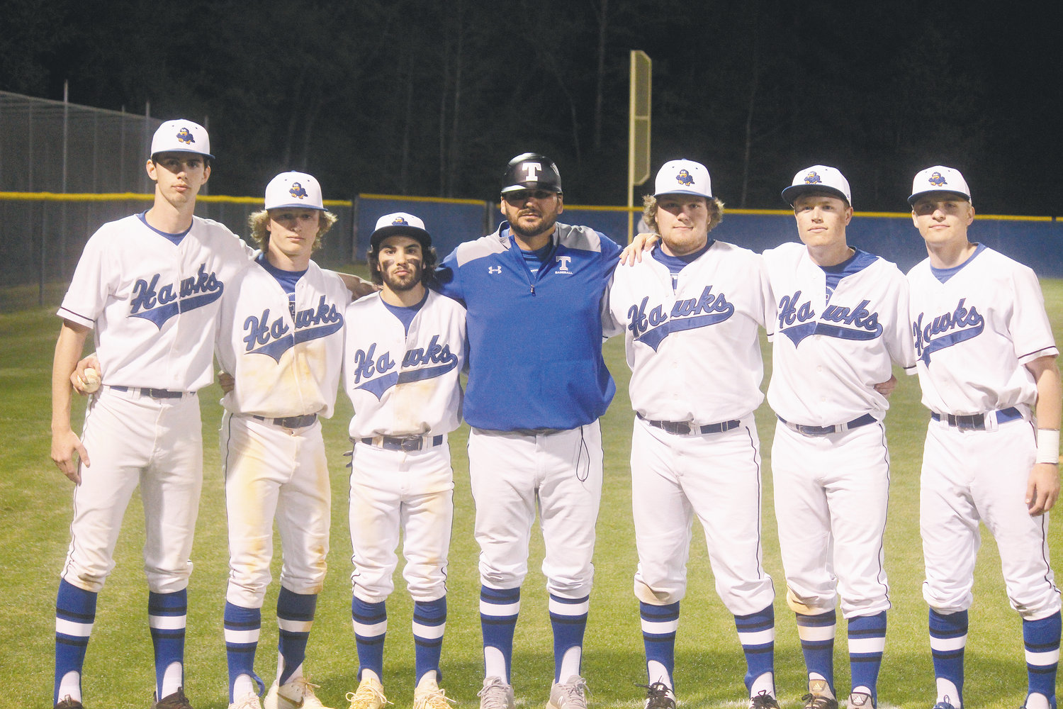 Triton baseball coach Joey Miriello (center) stands with his six seniors after the Hawks' 5-4 win over Lee County on Thursday. From left, they are: Colby Norris, Colton Neighbors, Bert Strickland, Greg Godwin, Parker Crews and Austin Riewestahl.